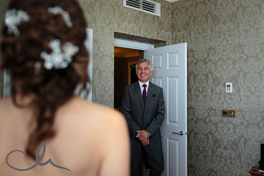 Brides father sees his daughter for the first time in her wedding dress