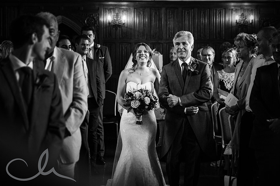 Bride walks down the Isle with her father at Lympne Castle