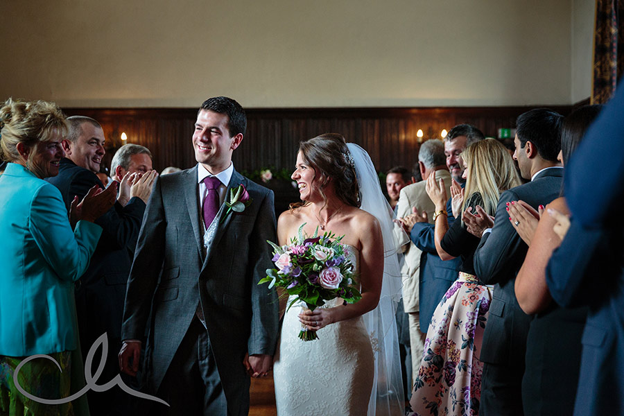 the newlyweds exit the aisle at Lympne Castle