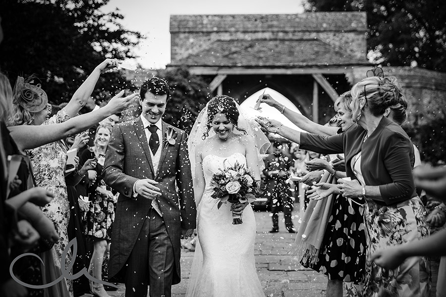 Bride and Groom get showered with confetti at Lympne Castle