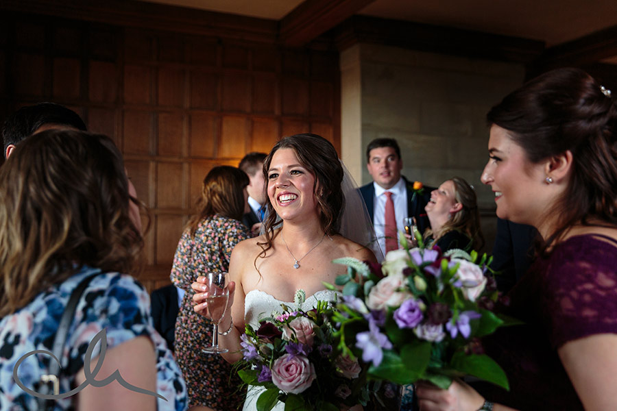 Bride chats with her guests at Lympn Castle Wedding reception