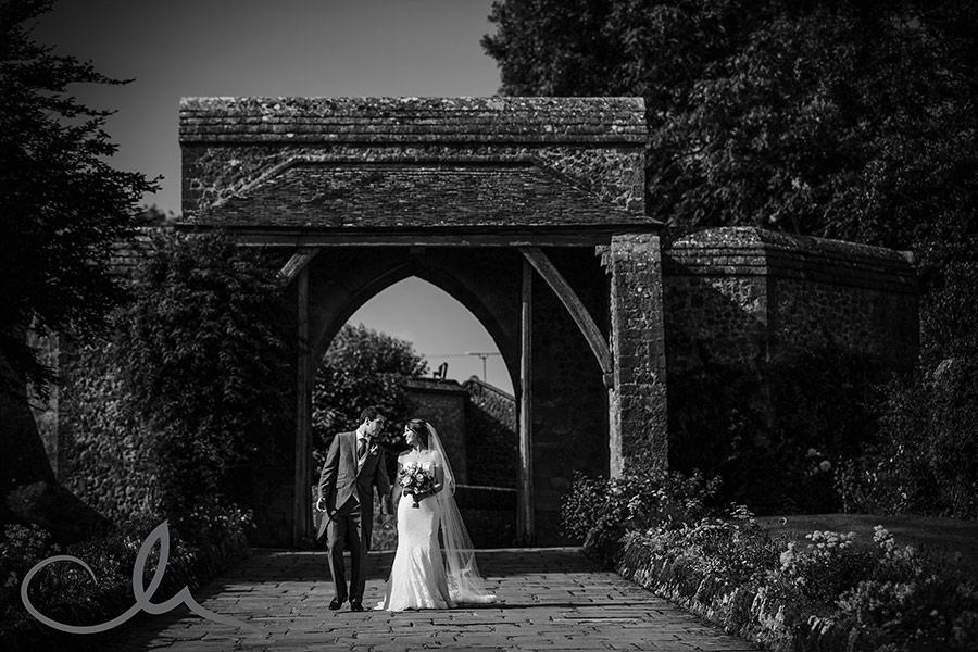Bride and Groom walk down the drive at Lympne Castle