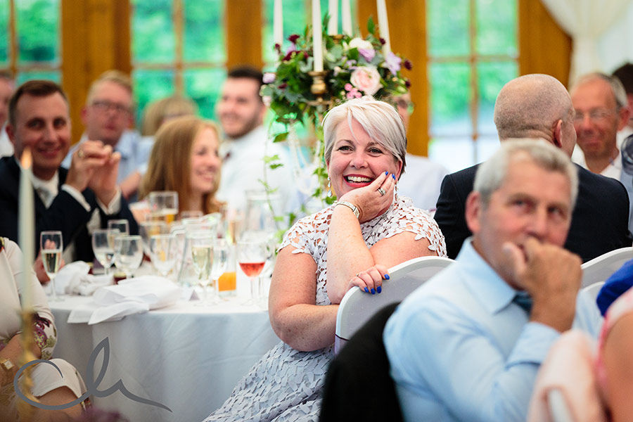 guest reacts to the speeches at Lympne Castle Wedding