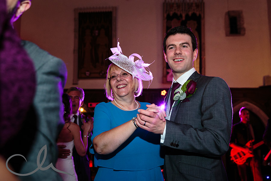 The groom dances with his mother at his Lympne Castle Wedding