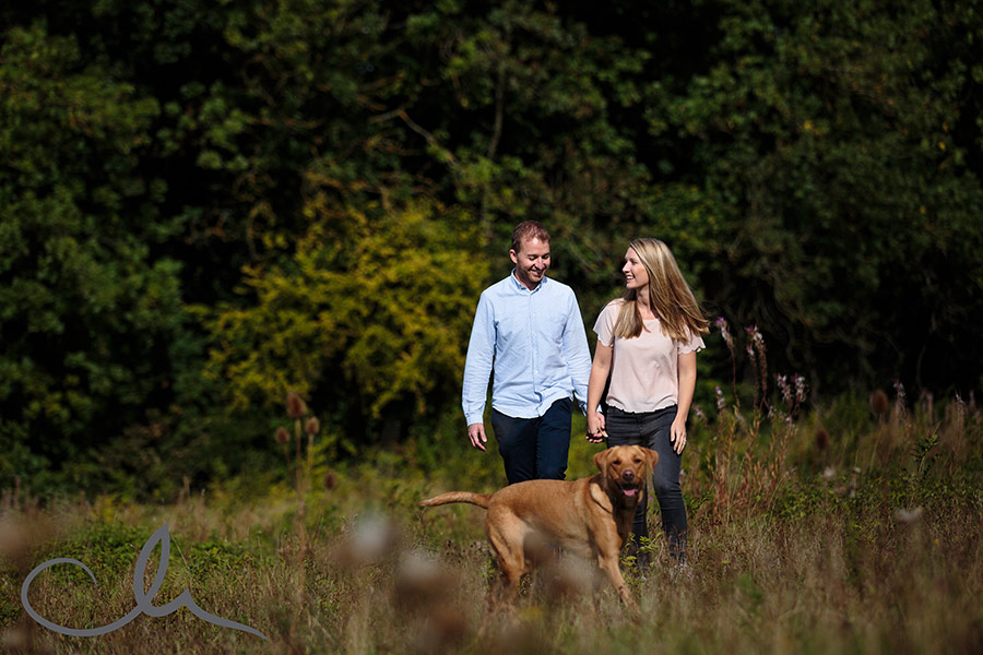 couple have a romantic stroll in the kent countryside