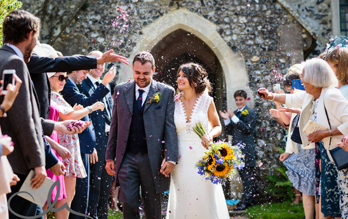 newlyweds are showered with confetti at Petham church Kent