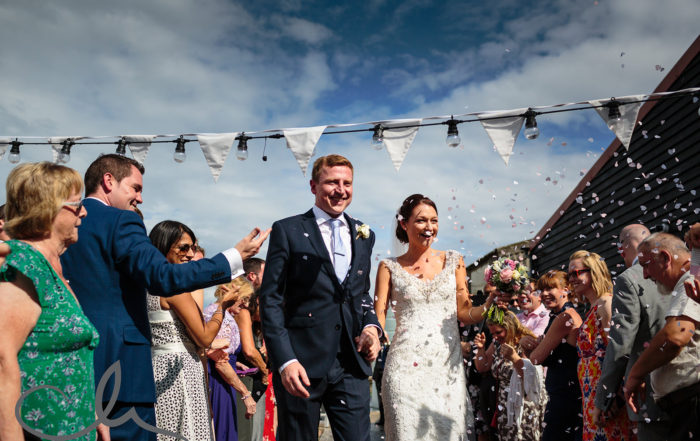 newlyweds are showered with confetti at East Quay wedding venue kent