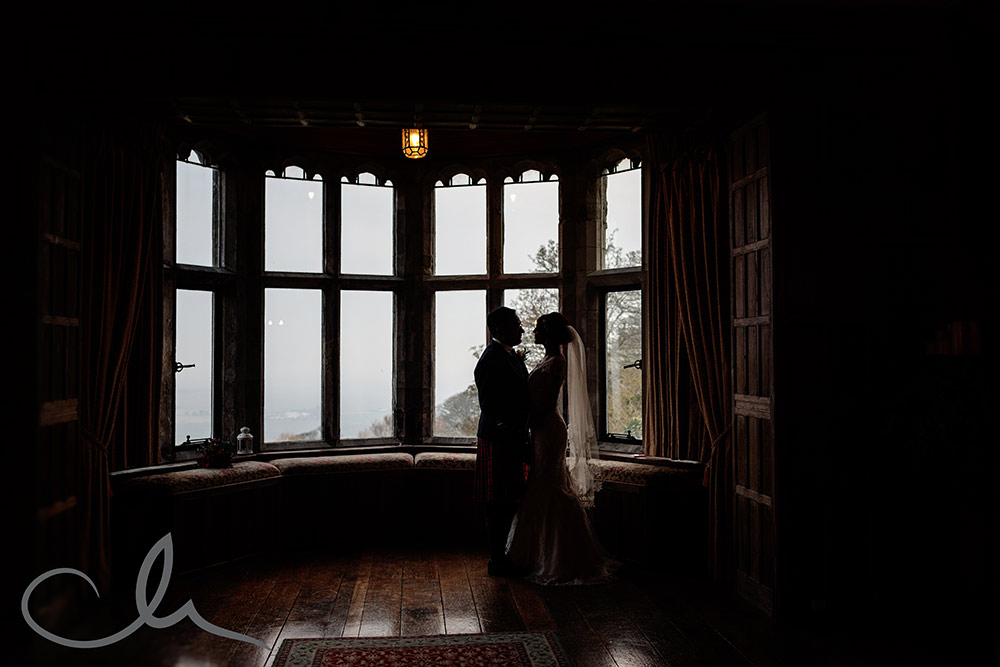 newlywed couple have their portraits photographed at Lympne Castle