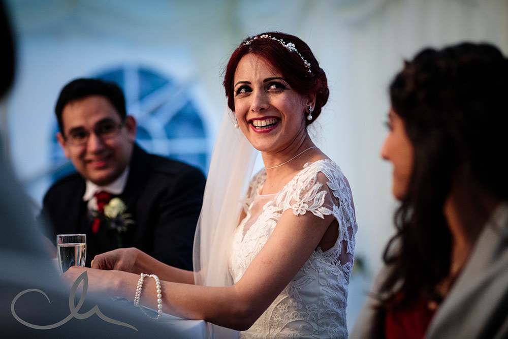 Bride reacts to speehes at Lympne Castle Wedding