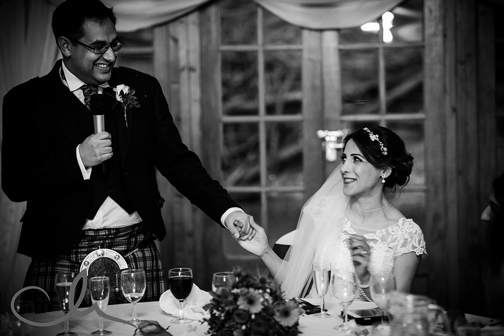 bride reacts to her husbands speech at Lympne Castle Wedding