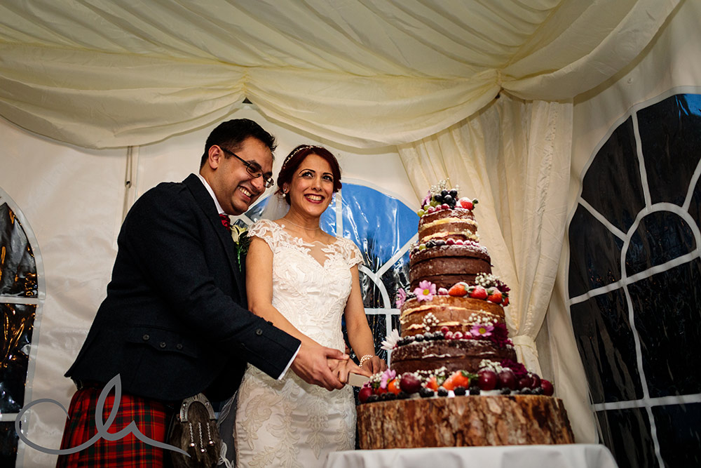 Newlyweds cut their cake at Lympne Castle