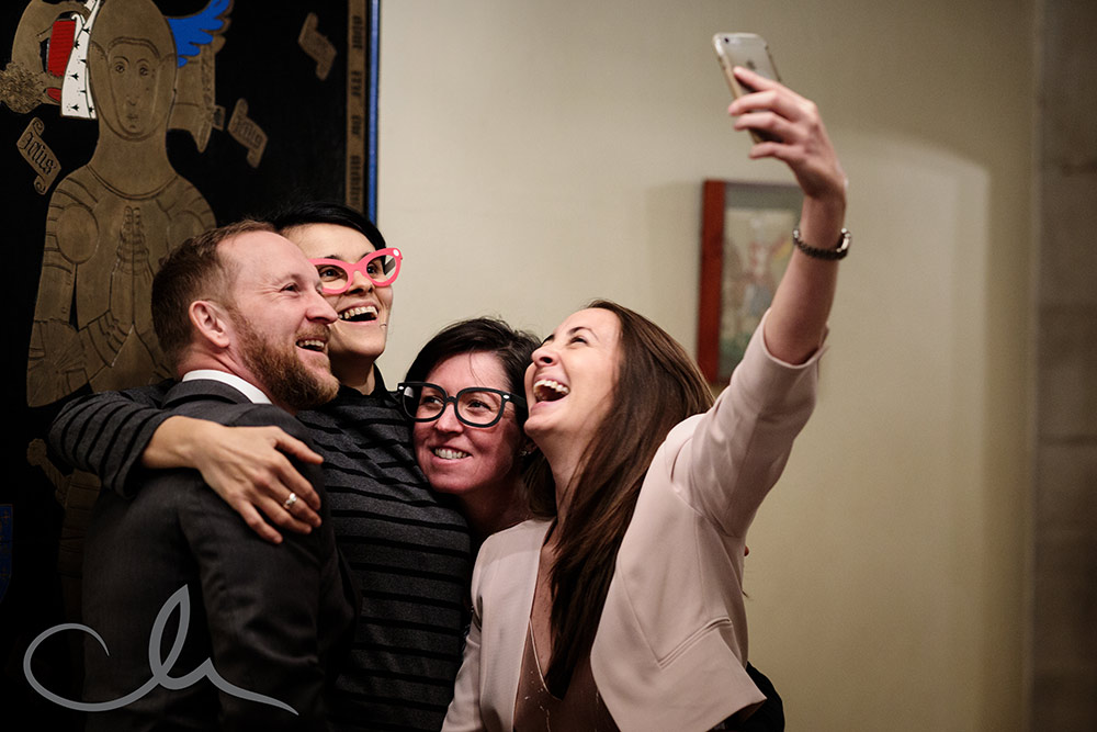 Guests take selfies at Lympne Castle Wedding reception