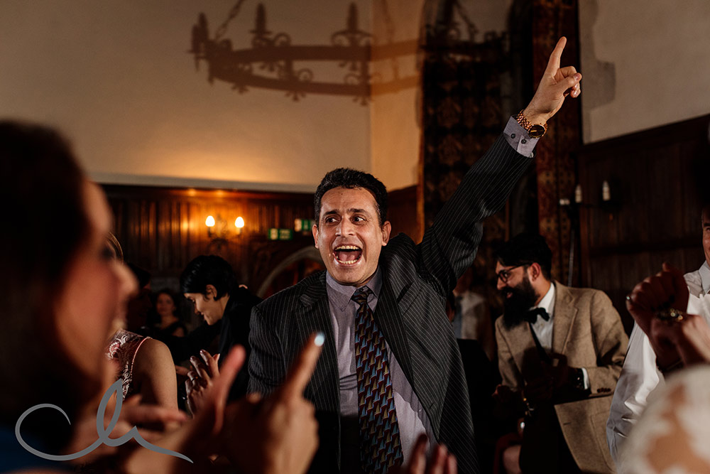 guests dance to Iranian music at a Lympne Castle Wedding