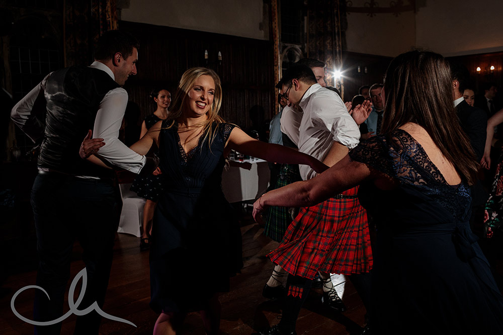 guests have a swinging time at a Cèilidh at Lympne Castle