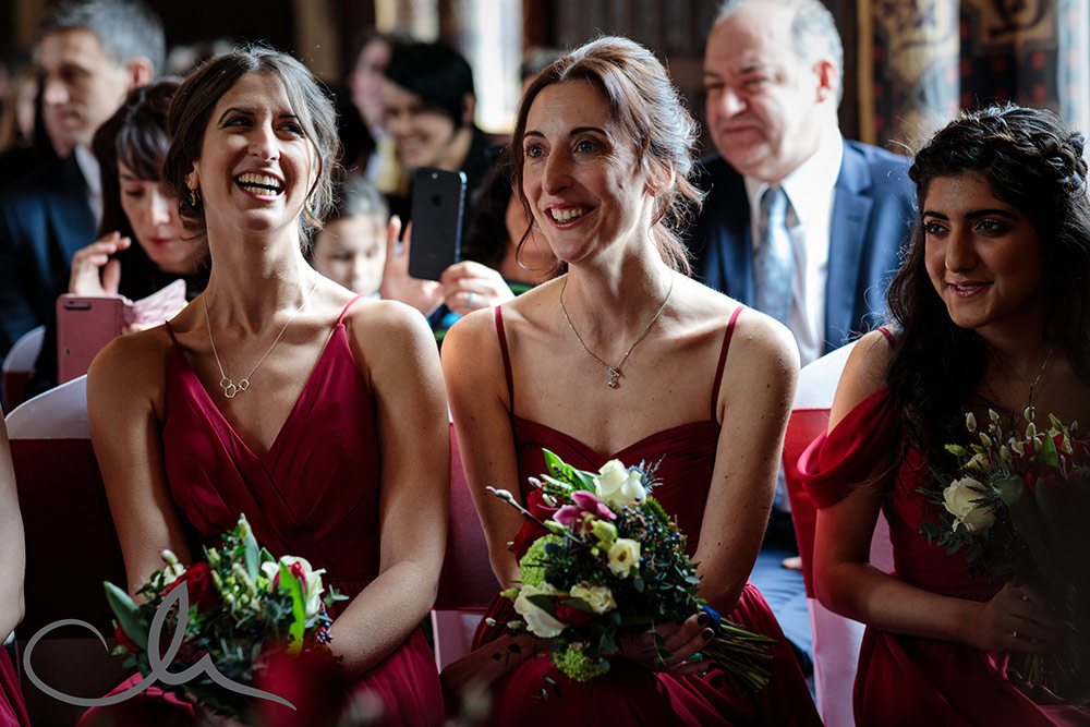 bridesmaids looking happy at Lympne Castle wedding