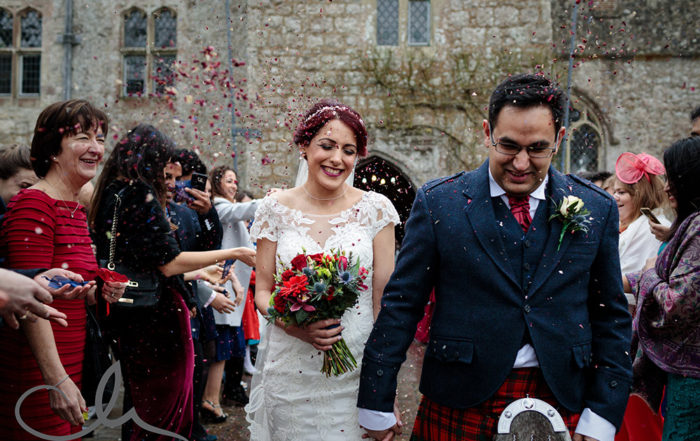 newlywed couple are showered with confetti at Lympne Castle Wedding